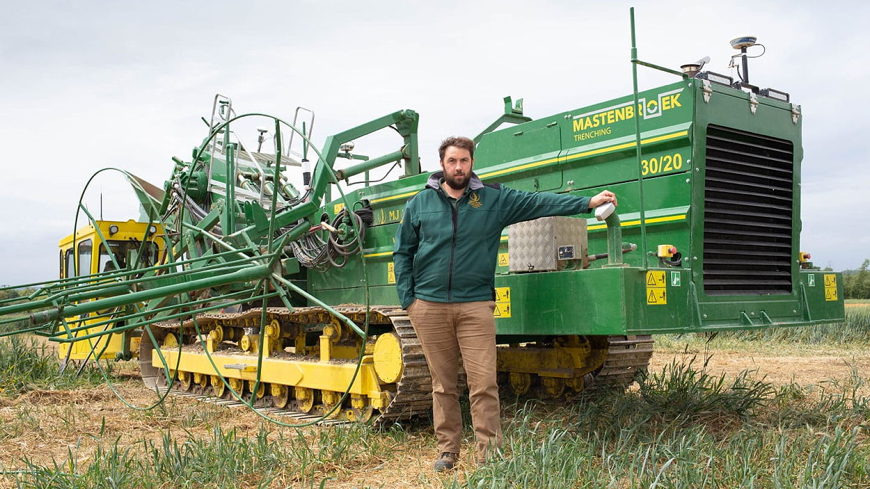 John Haynes, farm manager at MJ & SC Collins, with the Mastenbroek trencher