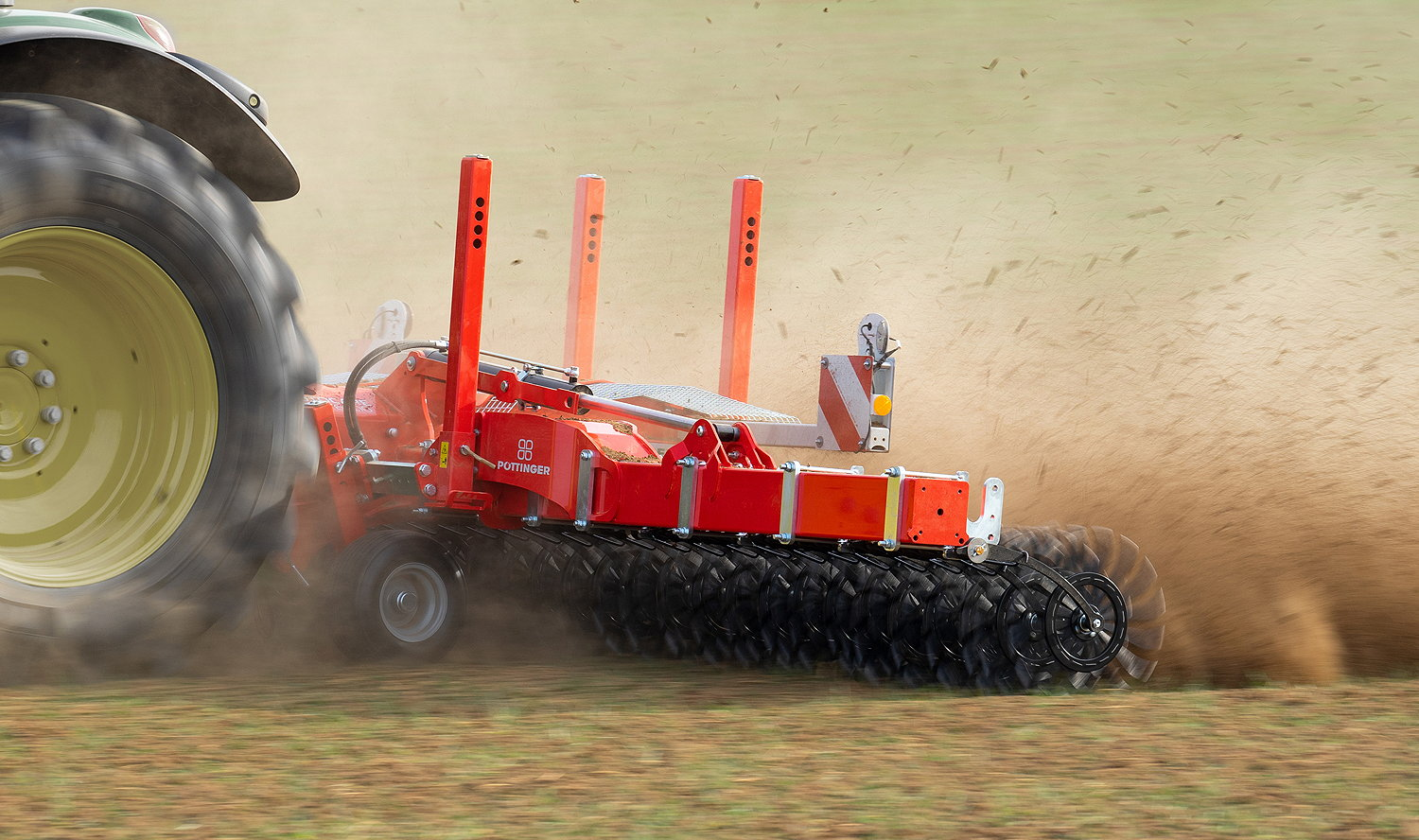 The Pöttinger RotoCare rotary hoe is used at 10 to 30 km/hr